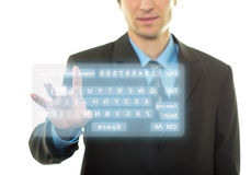 Hombre de negocios y teclado virtual Imágenes de archivo libres de regalías