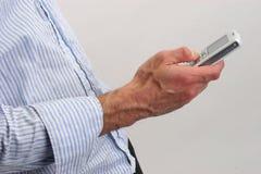 Hombre de negocios y teléfono móvil foto de archivo libre de regalías