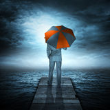 Hombre de negocios y tormenta en el mar Imagenes de archivo