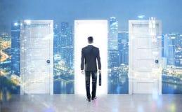 Hombre de negocios y tres puertas, dobles Fotos de archivo libres de regalías