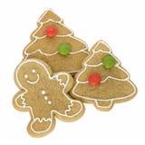 Hombre de pan de jengibre con las galletas de la Navidad Fotografía de archivo libre de regalías