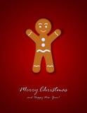 Hombre de pan de jengibre en fondo rojo Imagen de archivo libre de regalías