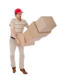 Hombre de salida con la pila que cae de rectángulos fotos de archivo libres de regalías