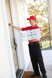 Hombre de salida de la pizza Foto de archivo libre de regalías