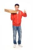 Hombre de salida de la pizza que muestra los pulgares para arriba Imagen de archivo libre de regalías