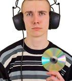 Hombre decepcionado triste con los auriculares y el CD grandes Fotografía de archivo