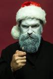 Hombre del Año Nuevo con el encendedor Fotos de archivo
