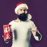 Hombre del Año Nuevo con la caja de regalo Fotografía de archivo