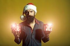 Hombre del Año Nuevo con los presentes Foto de archivo