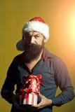 Hombre del Año Nuevo con los presentes Fotografía de archivo