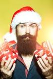 Hombre del Año Nuevo con los presentes Imágenes de archivo libres de regalías