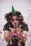 Hombre del confeti en partido Imagen de archivo libre de regalías