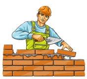 Hombre del constructor con la herramienta de derby que construye una pared de ladrillo Foto de archivo libre de regalías