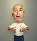 Hombre del creído que muestra los pulgares para arriba Fotos de archivo libres de regalías
