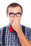 Hombre del empollón que sostiene la nariz Fotografía de archivo