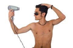 Hombre del encanto con el hairdryer Fotografía de archivo