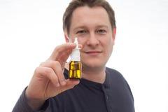 Hombre del espray nasal Imagen de archivo libre de regalías