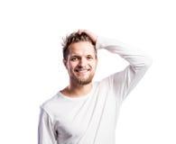 Hombre del inconformista en la camiseta blanca, tiro del estudio, aislado Fotografía de archivo libre de regalías