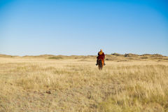Hombre del Kazakh en traje nacional Foto de archivo