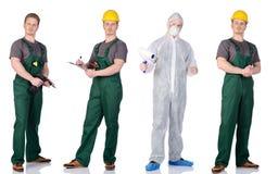 Hombre del pintor y trabajador de construcción en un traje protector Foto de archivo