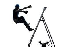 Hombre del trabajador manual que cae de silueta de la escalera Fotografía de archivo