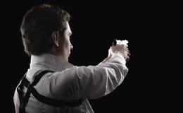 Hombre del yuong de la foto con el arma foto de archivo libre de regalías