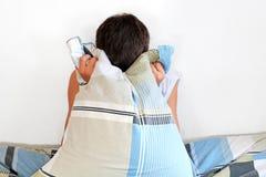 Hombre deprimido con la almohada Imagen de archivo libre de regalías