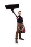 Hombre divertido con el aspirador Imagenes de archivo