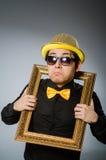 Hombre divertido con el marco Foto de archivo libre de regalías