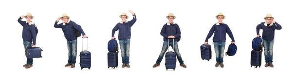 Hombre divertido con el sombrero del safari del equipaje que lleva foto de archivo libre de regalías