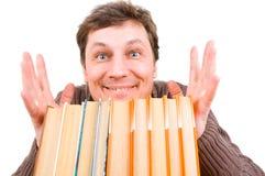 Hombre divertido con los libros Fotografía de archivo libre de regalías