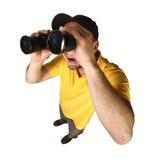 Hombre divertido con los prismáticos Fotografía de archivo