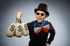 Hombre divertido con los sacos del dólar del dinero Fotos de archivo