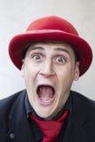 Hombre divertido en sombrero rojo Fotografía de archivo libre de regalías