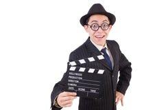Hombre divertido en traje elegante con la tablilla de la película Foto de archivo