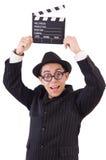 Hombre divertido en traje elegante con la tablilla de la película Imagenes de archivo