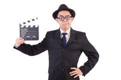 Hombre divertido en traje elegante con la tablilla de la película Fotos de archivo