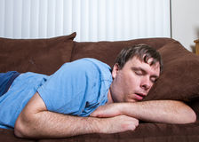 Hombre durmiente Imagen de archivo libre de regalías