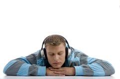 Hombre durmiente con el auricular Foto de archivo