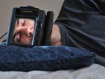 Hombre durmiente de la TV Fotografía de archivo