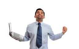 Hombre emocionado con éxito de la victoria de la computadora portátil imágenes de archivo libres de regalías