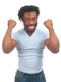 Hombre emocionado que celebra éxito Imagenes de archivo