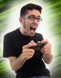 Hombre emocionado que juega a los juegos video Imágenes de archivo libres de regalías