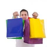 Hombre emocionado que sostiene compras o bolsos del regalo Imagen de archivo