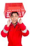 Hombre en batas rojas Fotos de archivo libres de regalías