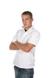 Hombre en blanco con los brazos cruzados Fotografía de archivo