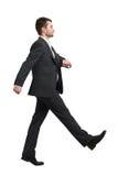 Hombre en caminar del desgaste formal Imagenes de archivo