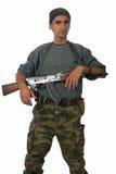 Hombre en camuflaje con el arma. Imagenes de archivo