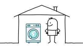 Hombre en casa y lavadora Imagen de archivo libre de regalías
