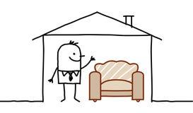 Hombre en casa y sofá Foto de archivo libre de regalías
